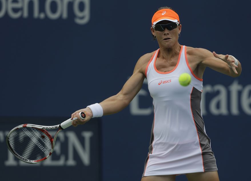 Australia's Samantha Stosur hits a forehand shot against Petra Martic of Croatia at the 2012 US Open Tennis tournament, Monday, Aug. 27, 2012, in New York. (AP Photo/Mike Groll)