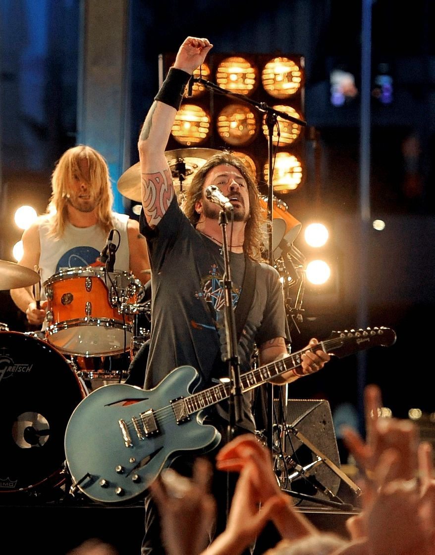 Dave Grohl and the Foo Fighters will perform four shows in the U.S. in September before taking some time off after completing a year-long world tour. (Associated Press)