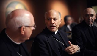 **FILE** Salvatore Cordileone (center), the Roman Catholic archbishop-elect of San Francisco, speaks July 27, 2012, with other members of the church during a press conference at St. Mary's Cathedral in San Francisco. (Associated Press)