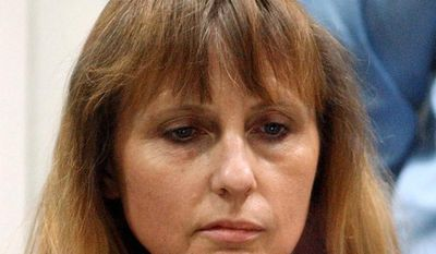 Michelle Martin, ex-wife of convicted rapist Marc Dutroux, attends a hearing at the Palace of Justice in Arlon, Belgium, in 2004. (AP Photo/Yves Logghe)