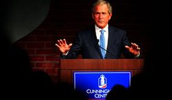 Former President George W. Bush begins his speech, Monday, Aug. 27, 2012, during the annual Jim Blanchard Leadership Forum at the Columbus Convention and Trade Center in Columbus, Ga., Monday, Aug. 27, 2012. (AP Photo/The Ledger-Enquirer, Mike Haskey)