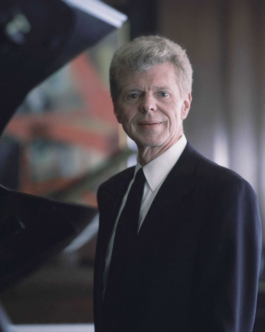 ** FILE ** Pianist Van Cliburn poses for a portrait at the Steinway & Sons showroom in New York on March 18, 1994. The renowned classical pianist has been diagnosed with advanced bone cancer and is resting comfortably at his Texas home, his publicist said Monday, Aug. 27, 2012. (AP Photo/Wyatt Counts, file)