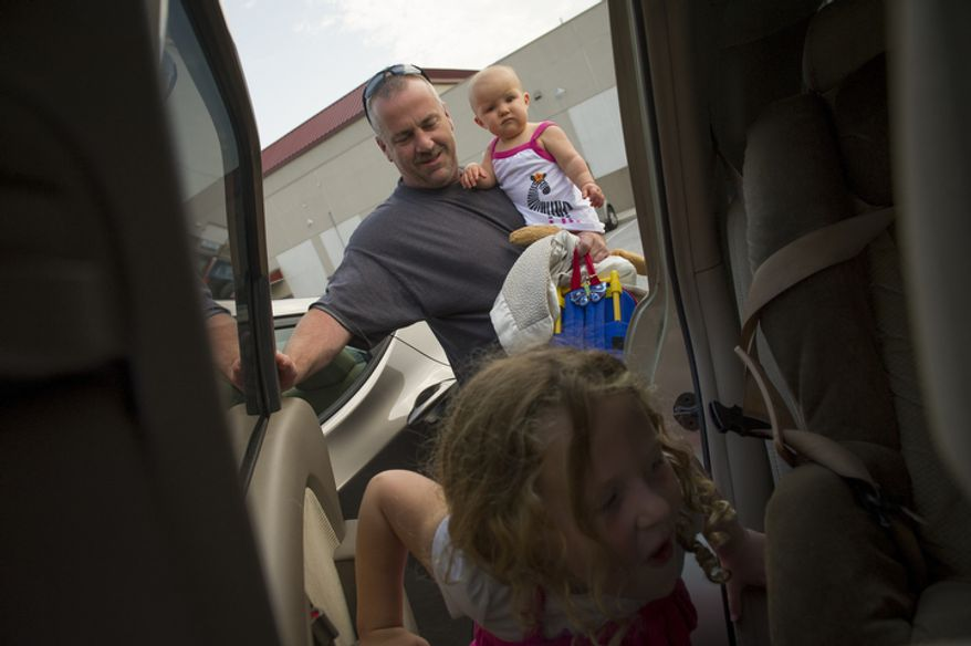 Joe Carr makes a run picking up his daughter Olivia, 8 months and Catalina, 5, at the end of the day in Downingtown, Pa., Friday, August 17, 2012.  Mr. Carr and his wife Sofia were at one point unemployed at the same time. The home they own was a foreclosed property which they renovated and currently live in. (Rod Lamkey Jr./The Washington Times)