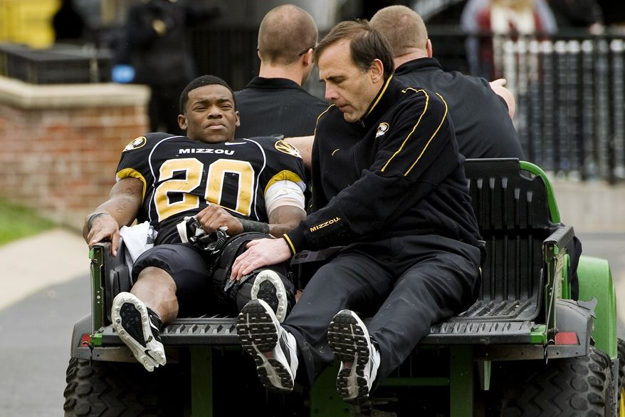 FILE - In this Nov. 12, 2011, file photo, Missouri tailback Henry Josey (20) is carted off the field under the supervision of team physician Pat Smith, right, after he injured his left knee during the third quarter of an NCAA college football game against Texas in Columbia, Mo. Head coach Gary Pinkel said on Monday, Aug. 27, 2012, that Josey will not play this upcoming season as he continues to recover from an injury that tore his ACL, MCL and patellar tendon. (AP Photo/L.G. Patterson, File)