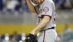 Washington Nationals starting pitcher Stephen Strasburg adjusts his hat during the third inning of a baseball game against the Miami Marlins, Tuesday, Aug. 28, 2012, in Miami. Strasburg gave up a career-high seven runs in five innings and the first-place Nationals' losing streak reached five games when they were defeated by Ricky Nolasco and the last-place Marlins 9-0. (AP Photo/Wilfredo Lee)
