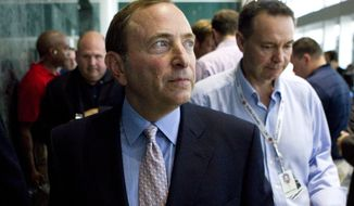 NHL commissioner Gary Bettman leaves after speaking to reporters after  NHL labor talks in Toronto, Thursday, Aug. 23, 2012. (AP Photo/The Canadian, Chris Young)