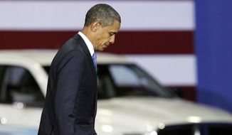 In this Friday, July 29, 2011, photo, President Barack Obama walks down a ramp after delivering a speech at a gathering where he announced new fuel efficiency standards for cars and light trucks at the Washington Convention Center in Washington.The average gas mileage of new cars and trucks will have to nearly double by 2025 under regulations that were finalized Tuesday, Aug. 28, 2012, by the Obama administration. The new rules would require the fleet of new cars and trucks to average 54.5 miles per gallon in 13 years, up from 28.6 mpg at the end of last year. (AP Photo/Manuel Balce Ceneta)