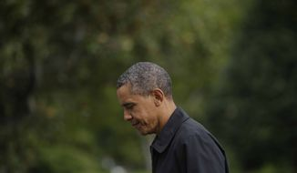 President Barack Obama walks across the South Lawn of the White House in Washington after his arrival from Camp David on Marine One helicopter, Sunday, Aug., 26, 2012. (AP Photo/Pablo Martinez Monsivais)