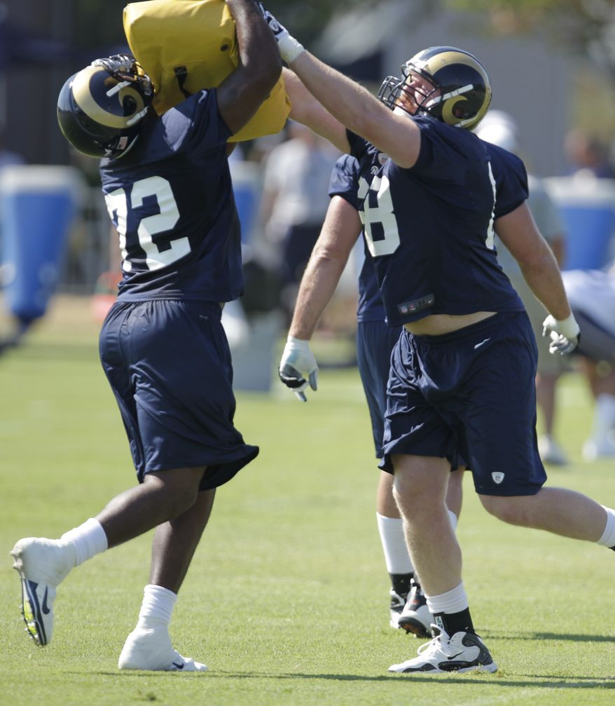 St. Louis Rams offensive tackle Jason Smith (72) drills with tackle Ryan McKee (68) during NFL football training camp, Tuesday, July 31, 2012 at the team's training facility in St. Louis. (AP Photo/Tom Gannam)