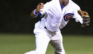 Chicago Cubs shortstop Starlin Castro bobbles a ground ball hit by Cincinnati Reds' Miguel Cairo in the second inning during a baseball game in Chicago, Thursday, Aug. 9, 2012. (AP Photo/Paul Beaty)