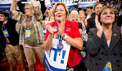 Wisconsin delegate Crystal Berg, center, gets emotional as Paul Ryan is nominated as the republican vice presidential nominee at the Republican National Convention, Tampa, Fla., Tuesday, August 28, 2012. (Andrew Harnik/The Washington Times)