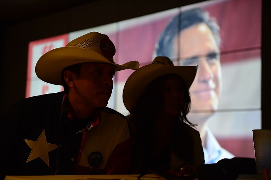 Texas delegates are silhouetted  by a movie about Mitt Romney at the Republican National Convention at the Tampa Bay Times Forum in Tampa, Fla. on Tuesday, August 28, 2012. (Andrew Harnik/ The Washington Times)