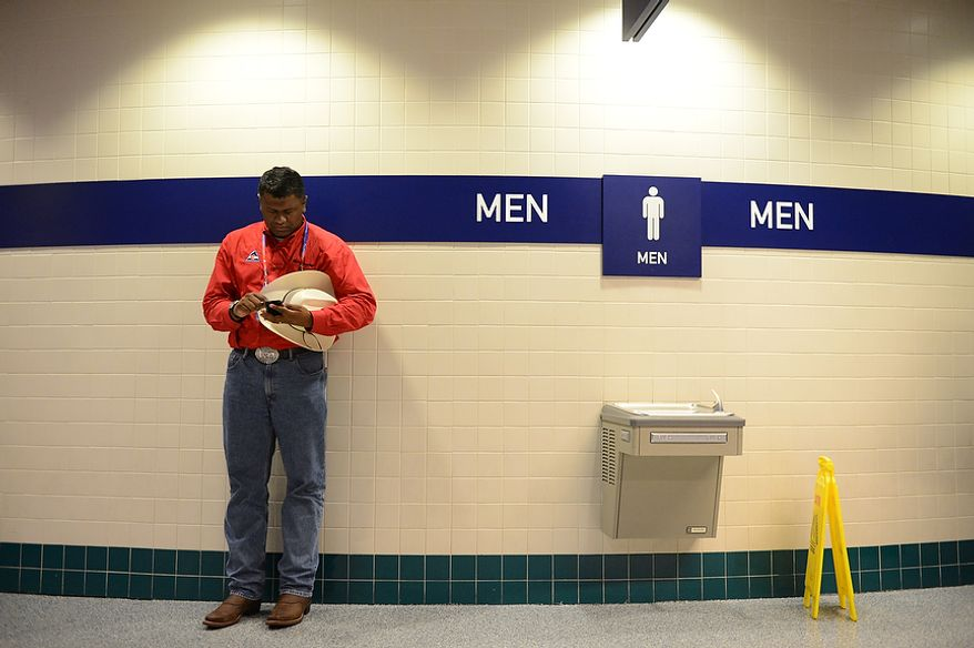 Anil Mathai [cq}, a delegate from Westminster, Colo. sends a text outside a restroom at the Republican National Convention at the Tampa Bay Times Forum in Tampa, Fla. on Tuesday, August 28, 2012. (Andrew Harnik/ The Washington Times)