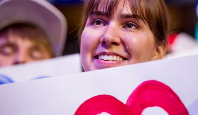 A tear rolls down the cheek of Mary Kanowsky, 22, of Peoria, Ill., as she listens to Ann Romney give a speech at the Republican National Convention, Tampa, Fla., Tuesday, August 28, 2012. (Andrew Harnik/The Washington Times)