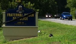 A sign outside the headquarters of the Fraternal Order of Police Lodge 89 in Upper Marlboro is draped in black to honor Prince George's County police Officer Adrian Morris, who died in an Aug. 20 car chase on Interstate 95. (Andrea Noble/The Washington Times)
