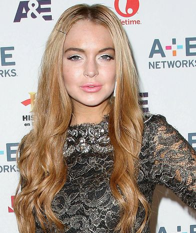 Actress Lindsay Lohan will not be charged in a burglary earlier this month at the Los Angeles home of an acquaintance. Prosecutors on Tuesday rejected the case presented by police, citing insufficient evidence. (Starpix via Associated Press)