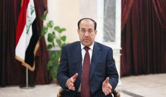 Iraq's Prime Minister Nouri al-Maliki is seen during an interview with The Associated Press in Baghdad, Iraq, Sunday, Feb. 28, 2010. Iraq's Prime Minister is defending a decision to ban hundreds of candidates from the upcoming election, saying that it would not hurt Sunni turnout for next Sunday's vote. (AP Photo/ Khalid Mohammed)