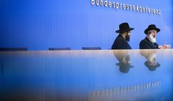 Ashkenazi Chief Rabbi of Israel Yona Metzger, right, and Berlin Rabbi Yehuda Teichtal brief the media at the Federal Press Conference organization in Berlin, Tuesday, Aug. 21, 2012. Israel's chief rabbi is in Germany for talks aimed at smoothing over controversy over the legality of circumcising young boys. German lawmakers have called for the government to draft a law this fall explicitly permitting 'medically correct circumcision'. That call came after a Cologne court concluded in June that circumcision amounts to bodily harm. (AP Photo/Markus Schreiber)
