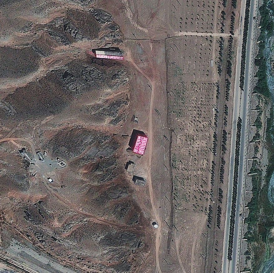 Buildings at Iran's Parchin military complex southeast of Tehran are shrouded with pink tarps in an effort, the Institute for Science and International Security says, to hide efforts to sanitize the site of suspected work on explosive charges used to detonate a warhead, in this photo dated Wednesday, Aug. 15, 2012. (AP Photo/ISIS)