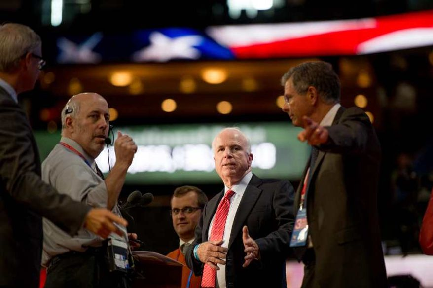 Sen. John McCain, Arizona Republican, does a sound test for his speech on stage at the Republican National Convention, Tampa, Fla., Wednesday, Aug. 29, 2012. (Andrew Harnik/The Washington Times)