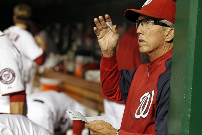 Washington Nationals manager Davey Johnson is seen in the dugout during a baseball game with the New York Mets at Nationals Park on Friday, Aug. 17, 2012, in Washington.( AP Photo/Alex Brandon)