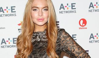 **FILE** Actress Lindsay Lohan attends the A&E Networks 2012 Upfront at Lincoln Center in New York on May 9, 2012. (Associated Press/Starpix, Kristina Bumphrey)