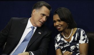 Republican presidential nominee Mitt Romney speaks with former Secretary of State Condoleezza Rice during the Republican National Convention in Tampa, Fla., on Tuesday, Aug. 28, 2012. (AP Photo/Charlie Neibergall)