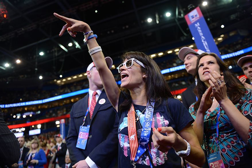 Massachusetts delegate Carol Claros, of Worchester, Mass., and Alternate Delegate Heather Mellem cheer on Rand Paul at the Republican National Convention at the Tampa Bay Times Forum in Tampa, Fla. on Wednesday, August 29, 2012. (Andrew Harnik/ The Washington Times)