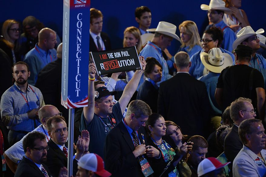 A Ron Paul supporter declares his allegiance at the Republican National Convention at the Tampa Bay Times Forum in Tampa, Fla. on Wednesday, August 29, 2012. (Rod Lamkey, Jr./ The Washington Times)