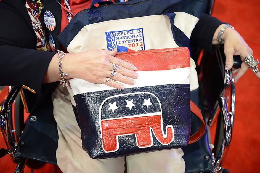 A woman shows off her Republican purse at the Republican National Convention at the Tampa Bay Times Forum in Tampa, Fla. on Wednesday, August 29, 2012. (Andrew Harnik/ The Washington Times)