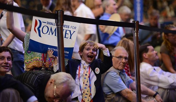 A young Republican waits for the appearance of vice presidential nominee, Rep. Paul Ryan, R-Wis., at the Republican National Convention at the Tampa Bay Times Forum in Tampa, Fla., on Wednesday, Aug. 29, 2012. (Andrew Harnik/The Washington Times)