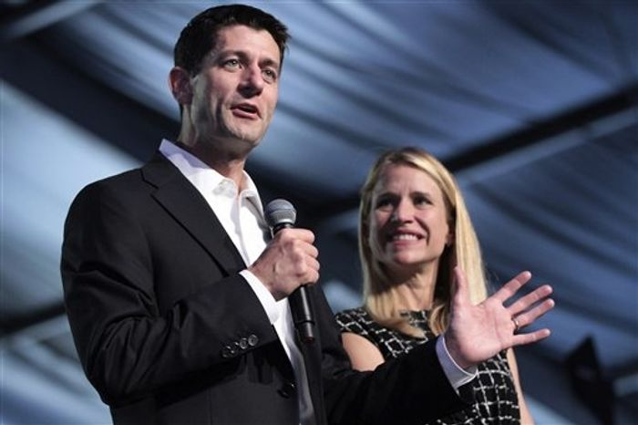 Republican vice presidential candidate, Rep. Paul Ryan of Wisconsin, and wife Janna appear on stage at the Wisconsin delegation's Beers and Brats event, Wednesday, Aug. 29, 2012, in Tampa, Fla. (AP Photo/Mary Altaffer)