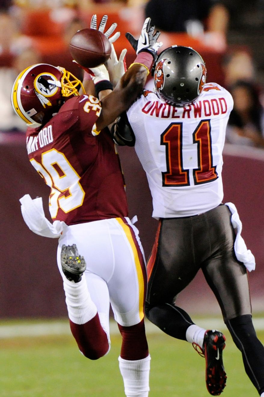 Washington Redskins cornerback Richard Crawford (39) intercepts a pass intended for Tampa Bay Buccaneers wide receiver Tiquan Underwood (11) during third quarter action. (Preston Keres/Special to The Washington Times)