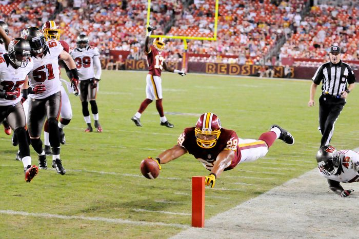 Washington Redskins running back Roy Helu (29) dives for a score on a 15-yard touchdown in the third quarter. (Preston Keres/Special to The Washington Times)