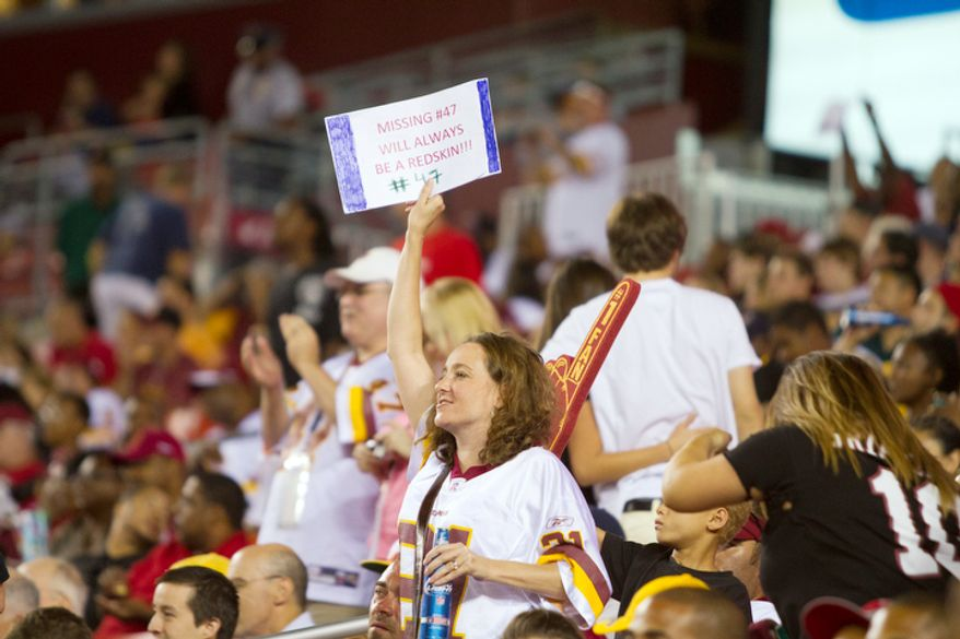 Fans show their missing of release Washington Redskins tight end Chris Cooley (47) at the Tampa Bay Buccaneers at Washington Redskins preseason football game. (Craig Bisacre/The Washington Times)
