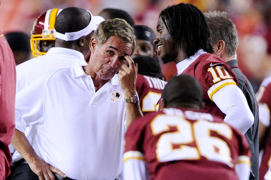 Washington Redskins head coach Mike Shanahan and quarterback Robert Griffin III (10)  joke on the sidelines in the closing minutes of the game. (Preston Keres/Special to The Washington Times)