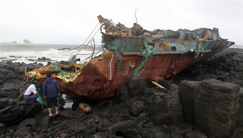 Wreckage of a Chinese ship sits on the shore after it slammed into rocks off the southern coast of South Korea near Jeju on Tuesday, Aug. 28, 2012. (AP Photo/Yonhap, Kim Ho-chun)