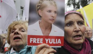 Supporters of former Ukrainian Prime Minister Yulia Tymoshenko take part in a rally outside Ukraine's High Specialized Court on Civil and Criminal Cases in Kiev on Wednesday, Aug. 29, 2012. The country's highest court on Wednesday upheld the guilty verdict against Tymoshenko, who is in jail on abuse-of-office charges. (AP Photo/Efrem Lukatsky)
