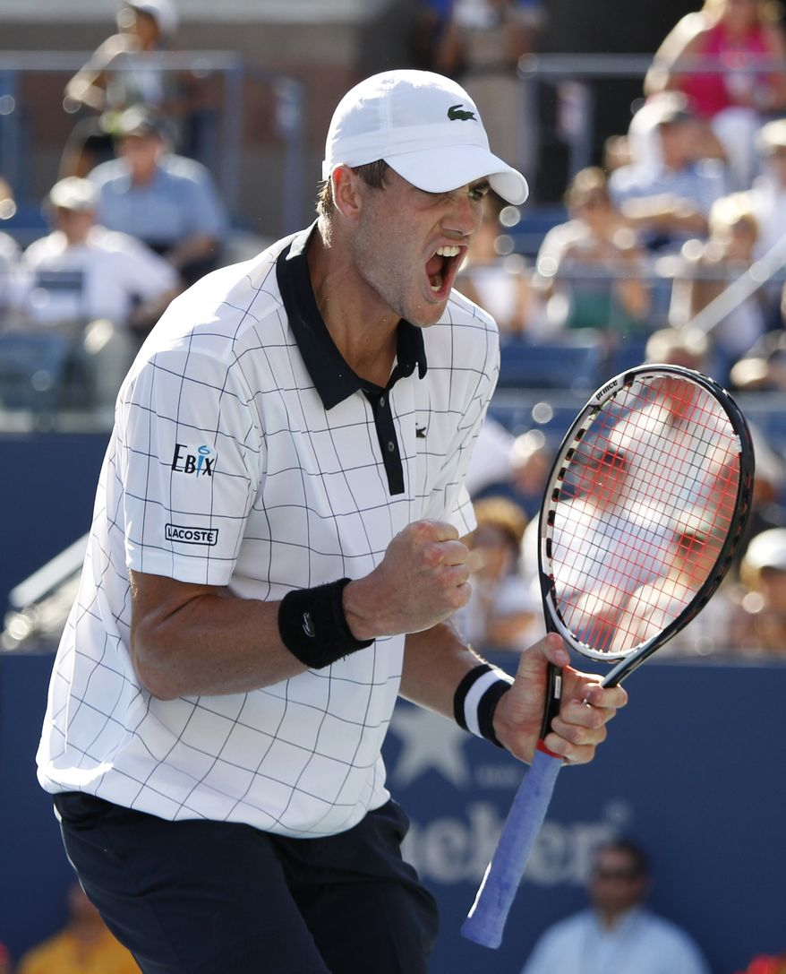 John Isner reacts during his match with Xavier Malisse of Belgium in the second round of play at the 2012 US Open tennis tournament,  Wednesday, Aug. 29, 2012, in New York. (AP Photo/Mel C. Evans)