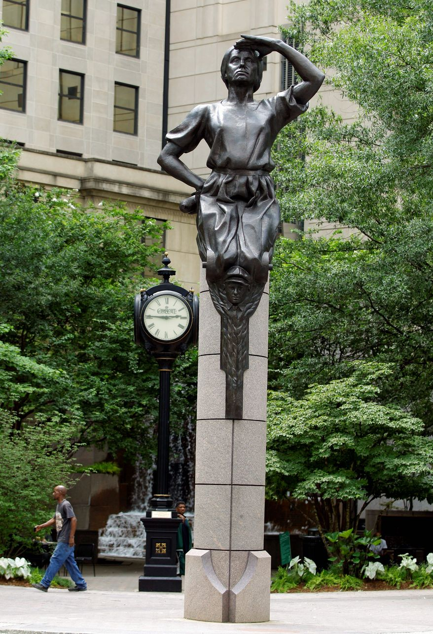 A statue at Independence Square in downtown Charlotte, N.C. Delegates in town for the Democratic National Convention, which begins Sept. 3, will find several places in and around Charlotte where they can soak up a little political history and culture. (Associated Press)