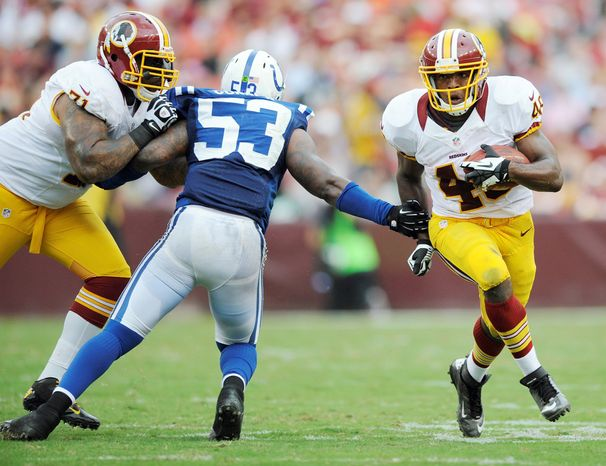 Washington Redskins offensive tackle Trent Williams (71) blocks Indianapolis Colts linebacker Kavell Conner (53) as running back Alfred Morris (46) moves past during the first half of an NFL preseason football game Saturday, Aug. 25, 2012, in Landover, Md. (AP Photo/Nick Wass)