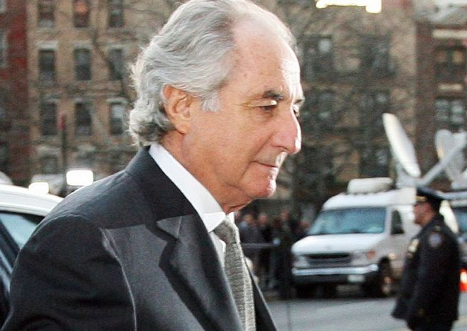 Bernard Madoff is serving a 150-year prison term for his Ponzi scheme that stole an estimated $36 billion from investors. (Associated Press) ** FILE **