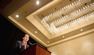 Wisconsin Gov. Scott Walker, who beat back a recall attempt in June, received one of the longest, sustained show of appreciation by the audience of any of the speakers at the Republican National Convention. (Andrew Harnik/The Washington Times)