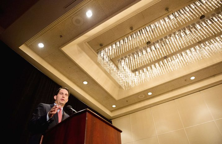 Wisconsin Gov. Scott Walker, who beat back a recall attempt in June, received one of the longest, sustained show of appreciation by the audience of any of the speakers a