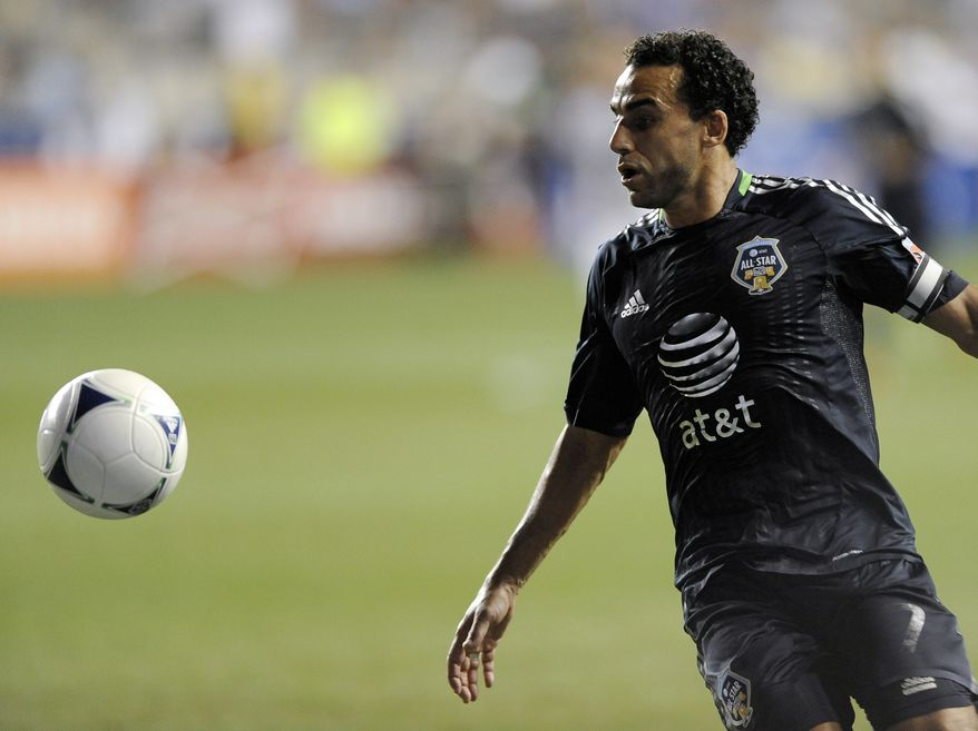 ** FILE ** MLS All-Stars' Dwayne De Rosario of D.C. United recieves a pass during the MLS All-Star game against Chelsea FC on Wednesday, July 25, 2012, in Chester, Pa. The MLS All Stars won 3-2. (AP Photo/Michael Perez)