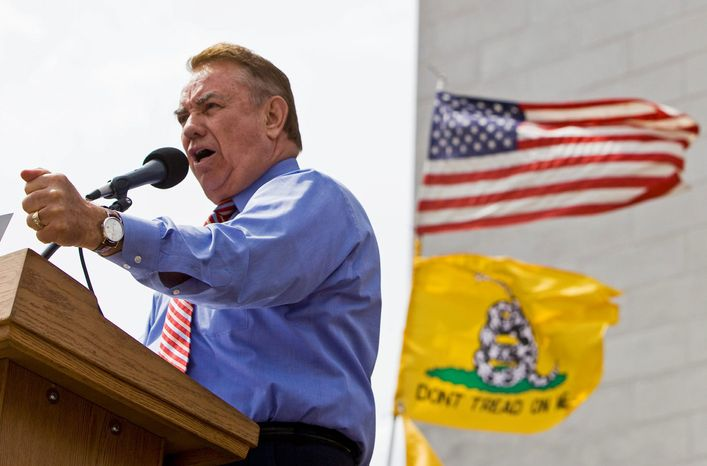 ** FILE ** Former Wisconsin governor Tommy Thompson addressing a tea party rally in Madison in 2010.