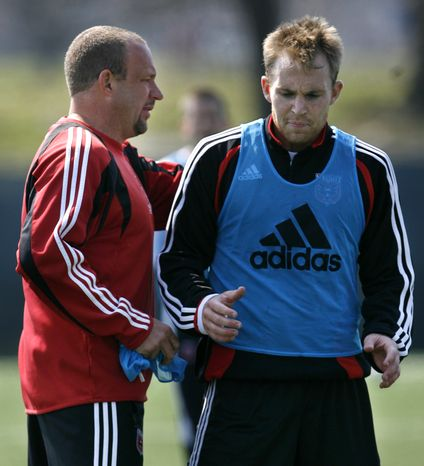 FILE - This March 22, 2007 file photo shows DC United head coach Thomas Soehn, left, talking with player Bryan Namoff at practice for the major league soccer team in Washington. Namoff has filed a $12 million lawsuit against the team and former coach Thomas Soehn, saying they rushed him back onto