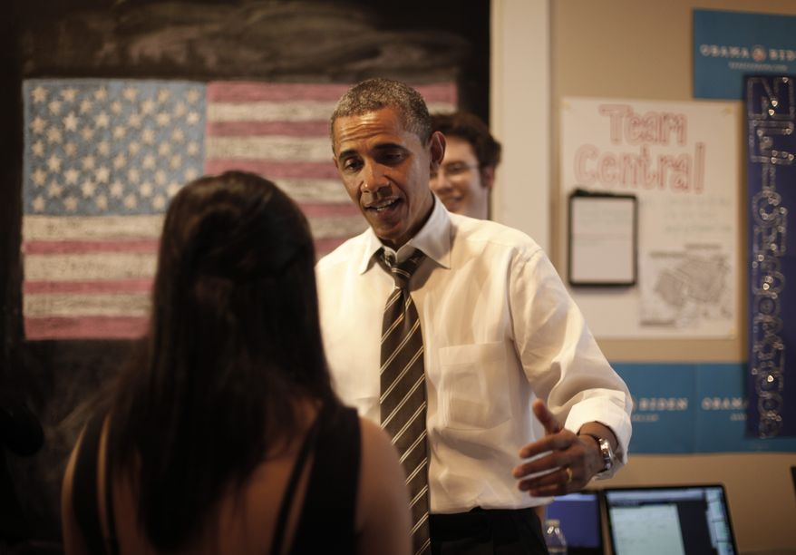 President Obama stops to greet campaign workers at the Obama for America field office in Charlottesville, Va., on Wednesday, Aug. 29, 2012. (AP Photo/Pablo Martinez Monsivais)