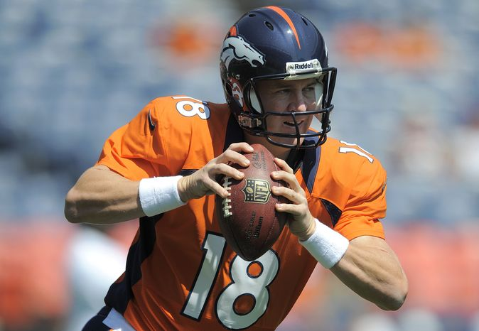 FILE - In this file photo taken Aug. 26, 2012, Denver Broncos quarterback Peyton Manning (18) warms up before an NFL preseason football game against the San Francisco 49ers in Denver. John Elway lured Manning to Denver with a five-year, $96 million deal, yet the 36-year-old quarterback is admittedly on a year-to-yea