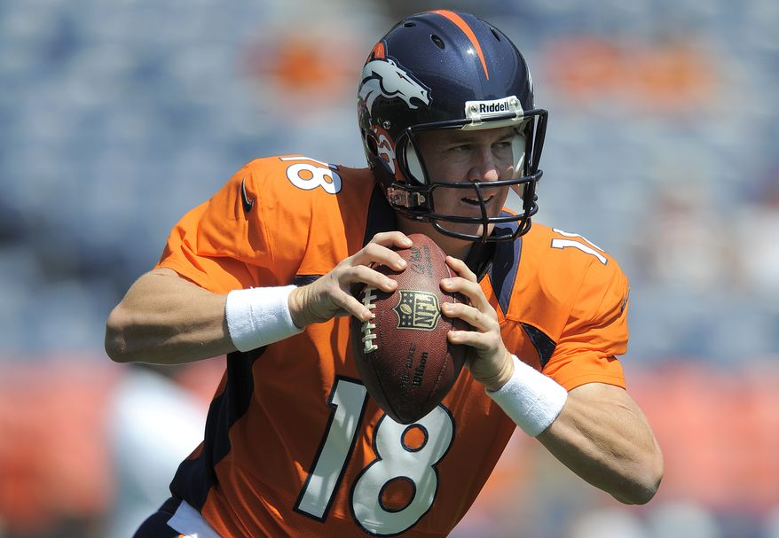FILE - In this file photo taken Aug. 26, 2012, Denver Broncos quarterback Peyton Manning (18) warms up before an NFL preseason football game against the San Francisco 49ers in Denver. John Elway lured Manning to Denver with a five-year, $96 million deal, yet the 36-year-old quarterback is admittedly on a year-to-year basis, which means he's all about winning now, not presiding over a rebuilding project. (AP Photo/Jack Dempsey, File)